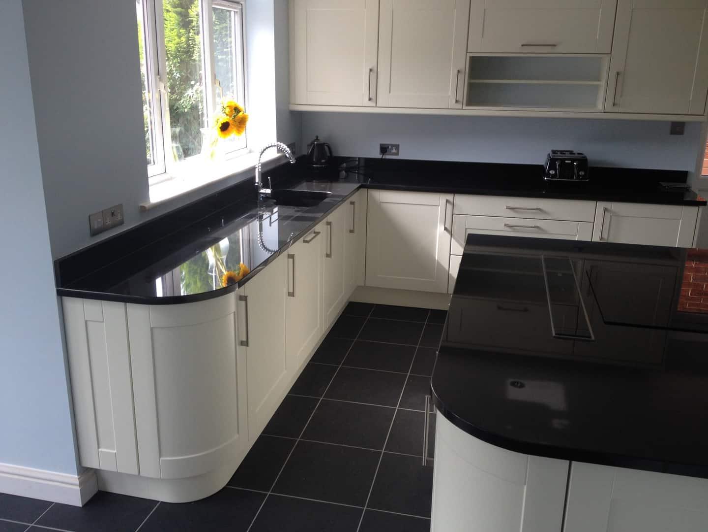 Matt Ivory Kitchen Black Granite Worktops Precision Kitchens